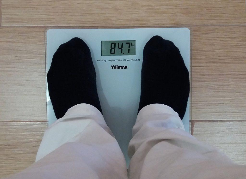 man weighing bmi