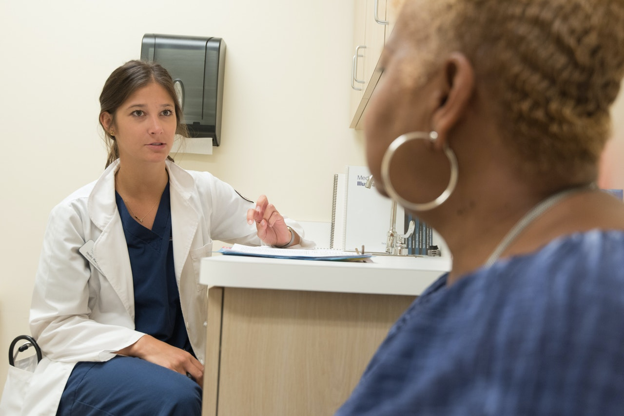 woman doctor referral patient